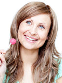 Delighted woman holding a lollipop — Stock Photo