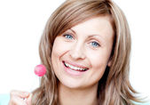 Smiling woman holding a lollipop — Stock Photo