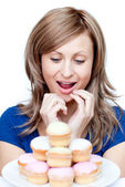 Impatient woman eating a cake — Stock Photo