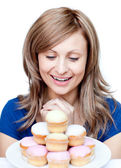 Cute woman eating a cake — Stock Photo