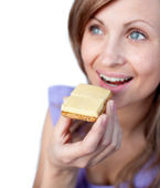 Radiant woman eating a cracker with cheese — Stock Photo