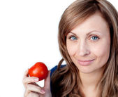 Attractive woman holding a tomato — Stock Photo