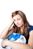 Displeased woman doing laundry — Stock Photo