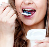 Close-up of a woman eating a yogurt — Foto de Stock