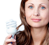 Cute woman is holding a lightbulb — Stock Photo