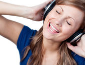 Cute woman listening music with headphone — Stock Photo