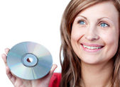 Delighted woman holding a cd-rom — Stock Photo