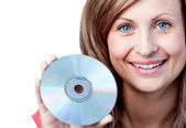 Cute woman holding a cd-rom — 图库照片