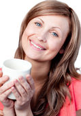 Cute woman drinking a cup of tea — Stock Photo