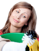Portrait of a cute woman doing housework — Stock Photo