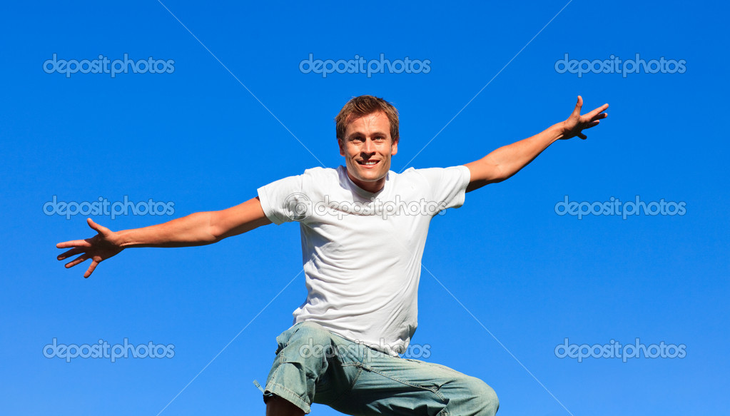 Young man jumping in the air against thr blue sky — Stock Photo #10310382