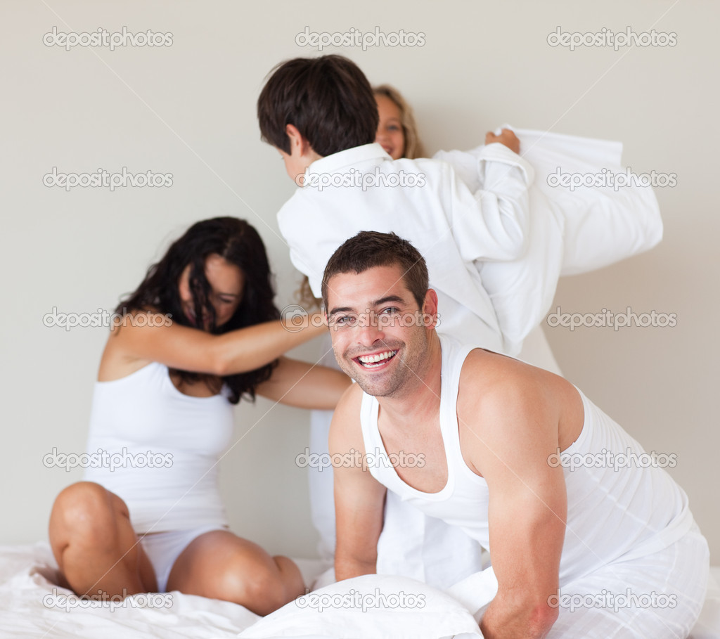 Lovely family having fun in a bedroom  Stock Photo #10311814