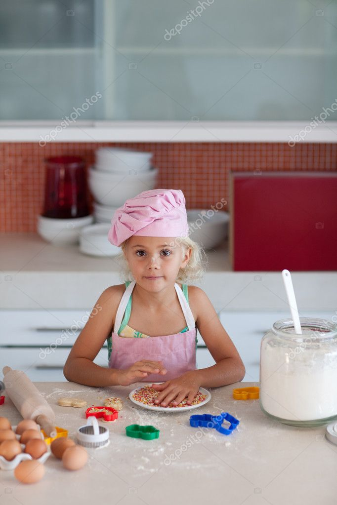 Cute daughter baking in a kitchen — Stock Photo #10311905