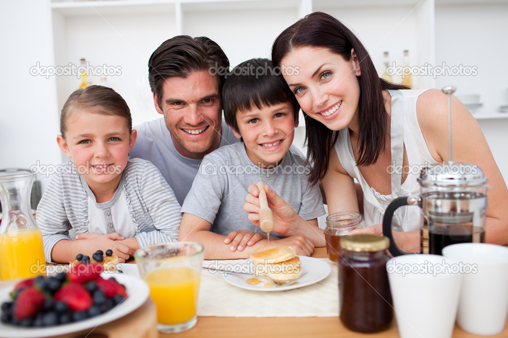 Family having healthy breakfast together in the kitchen  Stock Photo #10317018