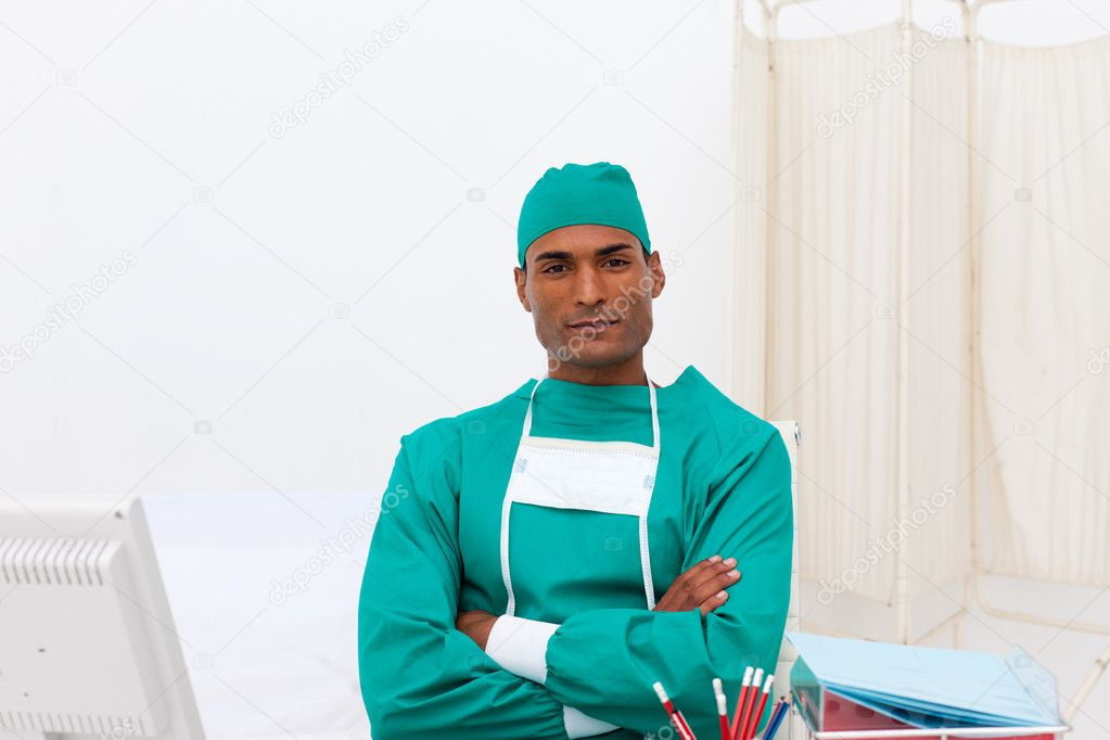 Portrait of a serious surgeon at his desk in the hospital — Stock Photo #10317160