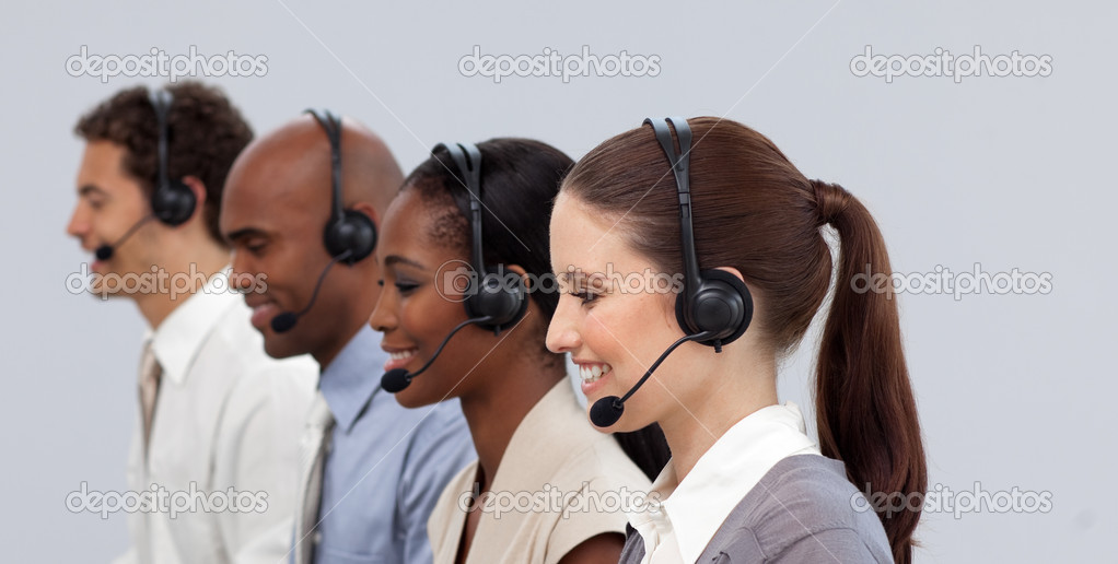 Multi-ethnic young business partners with headset on working in a call center — Stock Photo #10317794