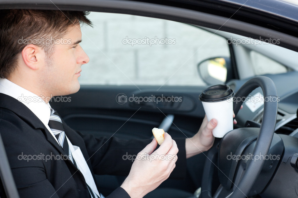 Handsome businessman talking on the phone in a car  Stock Photo #10318455