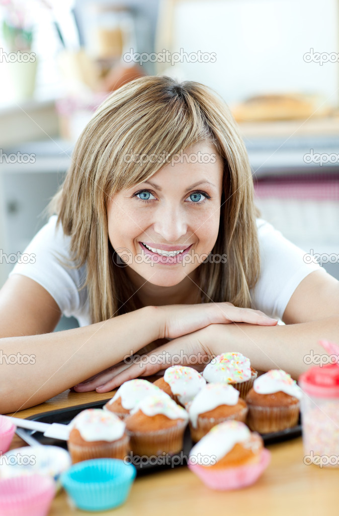 Delighted woman eating cakes in the kitchen at home — Stock Photo #10318783