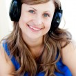 Bright woman is listening the music with headphones — Stock Photo