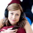 Attractive woman is listening the music with headphones — Stock Photo