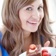 Cheerful woman holding a piece of chocolate cake — Stock Photo #10320097