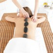 Delighted woman having a massage — Stock Photo