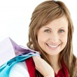 Pretty woman holding shopping bags — Stock Photo