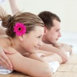 Jolly young couple receiving a back massage — Stock Photo #10320539