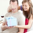 Royalty-Free Stock Photo: Smiling woman giving a present to her boyfriend