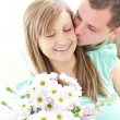 Loving man giving a bunch of flowers to his girlfriend — Stock Photo