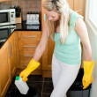 Confident housewife cleaning — Stock Photo