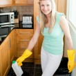 Attractive housewife cleaning — Stock Photo