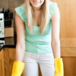 Stock Photo: Smiling housewife cleaning