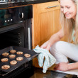 Beautiful housewife preparing cookies — Stock Photo