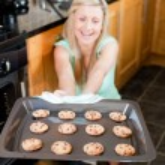 Smiling housewife preparing cookies — Stock Photo #10320643