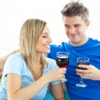 Stock Photo: Adorable couple drinking wine together in living-room
