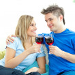 Beautiful couple drinking wine together in the living-room — Stockfoto