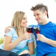 Beautiful couple drinking wine together in the living-room — Foto de Stock