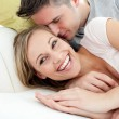 Stock Photo: Happy lovers having fun together on sofa