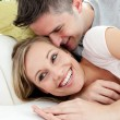 United lovers having fun together on a sofa — Stock Photo
