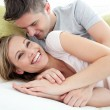 Joyful lovers having fun together on a sofa — Stock Photo #10320838