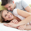 Stock Photo: Joyful lovers having fun together on sofa