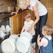 Stock Photo: Familie standing besides dishwaser