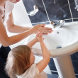Stock Photo: Mother and cute child washing their hands