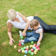 Handsome mother playing with her child — Stock Photo