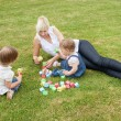 Stock Photo: Family playing with toys