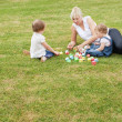 Family sitting in the grass — Stock Photo