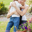 Little girl embrace her mother — Stock Photo