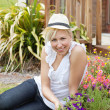 Portrait of a handsome woman in the garden — Stock Photo