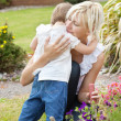Shy girl embrace her mother — Stock Photo